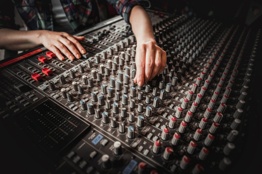 Sound engineer at a mixing desk